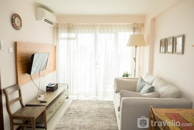 Homey 2BR with Private Roof Garden Gateway Pasteur Apartment By Travelio