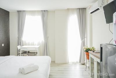 Compact and Monochrome Studio Room Bintaro Icon Apartment By Travelio