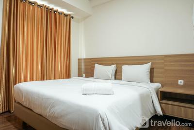 Minimalist and Comfy Puri Orchard Studio Apartment By Travelio