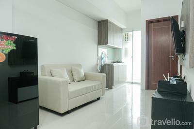 Fully Furnished Apartment with Comfortable Design 2BR Vittoria Residence By Travelio