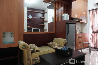 Homey and Warm 2BR Green Pramuka Apartment By Travelio