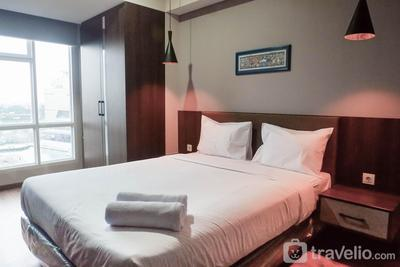 Classy 1BR Apartment with Pool View at Grand Sungkono Lagoon By Travelio