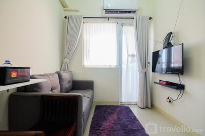 Tranquil 2BR @ Green Pramuka Apartment By Travelio
