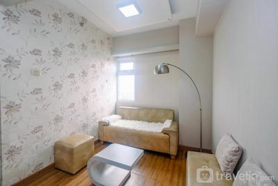 Cozy and Simple 1BR Green Pramuka Apartment near Mall By Travelio