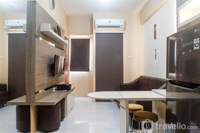 Modern City View 2BR Apartment at Puncak Dharmahusada By Travelio