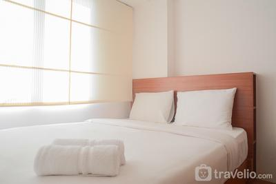 Pool View 2BR with Sofa Bed Bassura City Apartment By Travelio