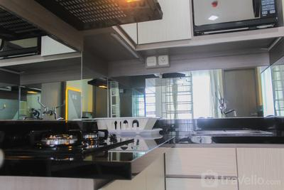 Cozy and Homey 2BR at Emerald Bintaro Apartment By Travelio
