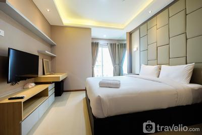 Deluxe and Comfortable 2BR Seaview Condominium at Green Bay Apartment By Travelio