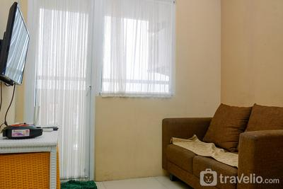 Compact and Homey 2BR at Green Pramuka Apartment By Travelio