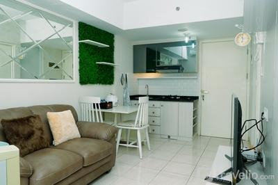 Best 2BR + Extra Room with Sofa Bed at Springlake Summarecon Bekasi Apartment By Travelio