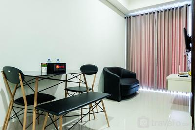 Modern 1BR Puri Mansion Apartment with City View By Travelio