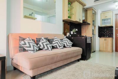 Homey Rustic 2BR Apartment at Signature Park Grande By Travelio
