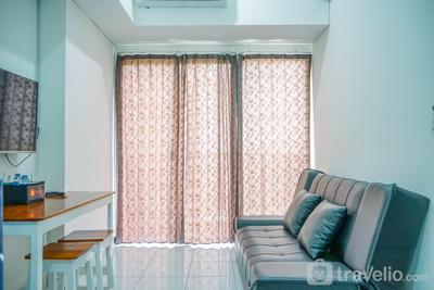 Fully Furnished and Homey 1BR Casa De Parco Apartment By Travelio