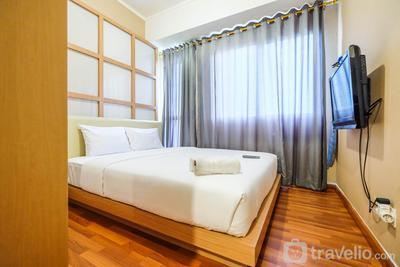 Comfortable 1BR The Oasis Lippo Cikarang Apartment By Travelio