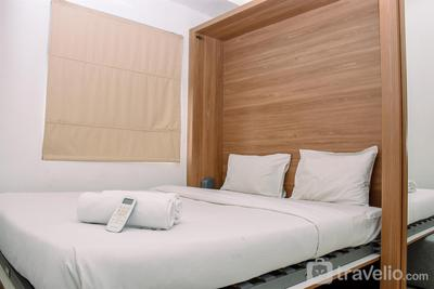 Cozy Living 2BR at Green Pramuka City Apartment near Shopping Area By Travelio