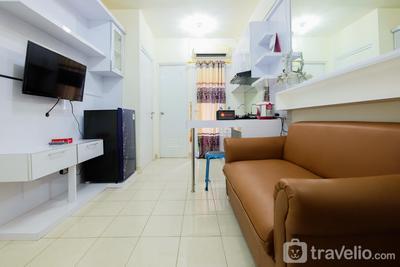 Minimalist 2BR at Green Pramuka Apartment By Travelio