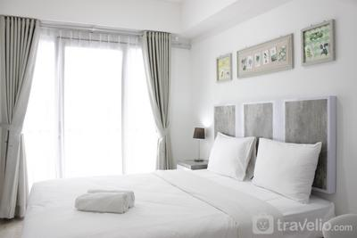 Modern Look Studio Apartment at Grand Asia Afrika By Travelio