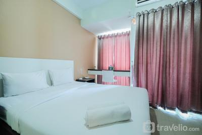 Simply Modern Studio Grand Dhika City Apartment By Travelio