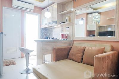 Homey and Fresh 2BR Green Pramuka Apartment By Travelio