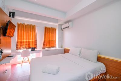 Fresh and Simple Studio Room at Patraland Urbano Apartment By Travelio