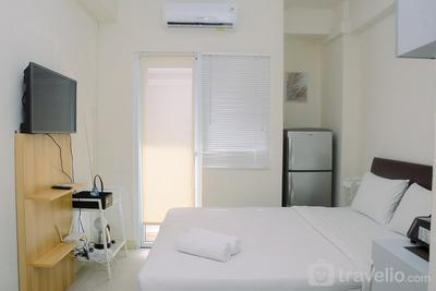 Comfort Studio at Green Pramuka Apartment near Shopping Center By Travelio
