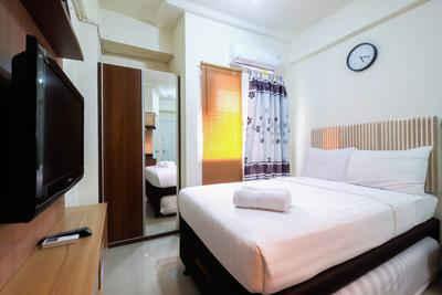 Studio Green Pramuka City Apartment with Mall Access By Travelio