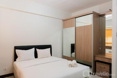 Cozy with City View Studio at Scientia Apartment By Travelio
