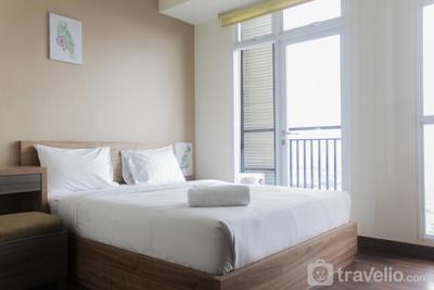 High Floor and Strategic Studio at Puri Orchard Apartment By Travelio