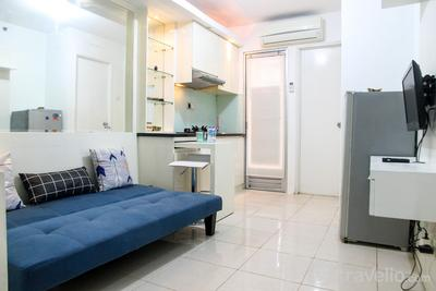 Modern White 2BR Kalibata City Apartment By Travelio