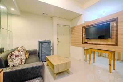 Strategic 2BR Apartment with Workspace @ Season City By Travelio