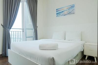 Minimalist and Relaxing 1BR Apartment at Puri Orchard By Travelio