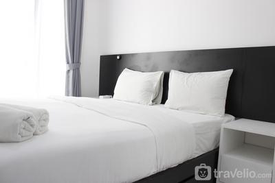 Monochrome Style Studio Room @Grand Asia Afrika Apartment By Travelio