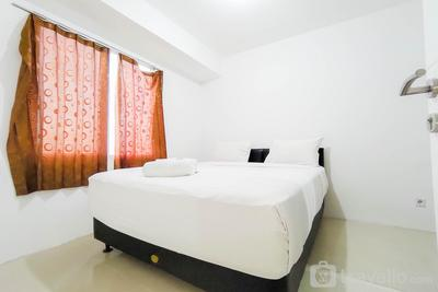 Scenic 2BR with City View at Bassura City Apartment By Travelio
