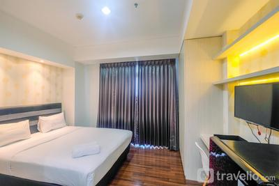 Relaxing and Strategic Studio Apartment at Puri Orchard By Travelio