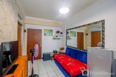 Homey and Compact 2BR Cibubur Village Apartment By Travelio