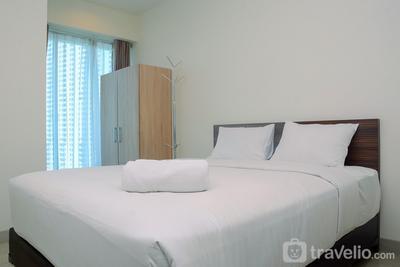 Relaxing and Homey Studio Grand Kamala Lagoon Apartment By Travelio