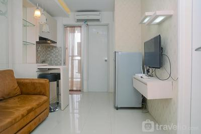 Fully Furnished 2BR Bassura City Apartment with Mall View By Travelio