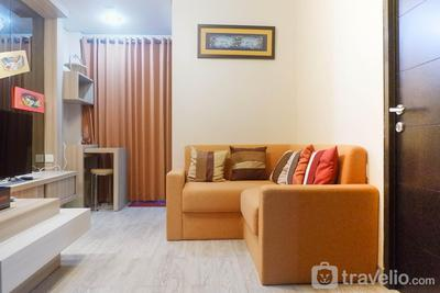 Homey 2BR Apartment at Tamansari Papilio By Travelio