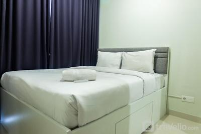 Comfortable 1BR Puri Mansion Apartment By Travelio