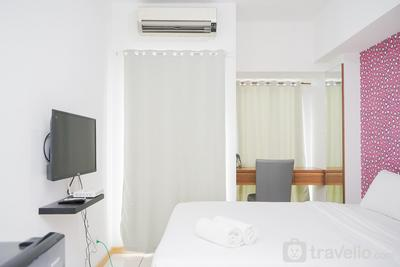 Cozy and Good Location Studio Apartment M-Town Residence By Travelio
