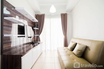 Elegant and Spacious 1BR Saveria Apartment near ICE BSD By Travelio