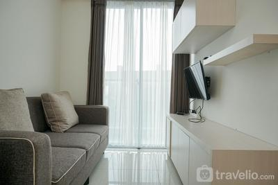Comfort 1BR Sedayu City Suites Apartment By Travelio