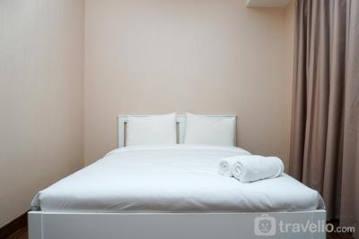 Brand New 1BR Puri Orchard Apartment By Travelio