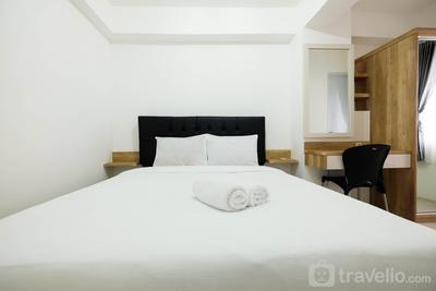 1BR with Sofa Bed at Bassura City Apartment By Travelio