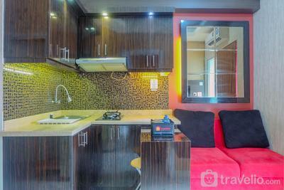 Warm 2BR Apartment at Green Pramuka City By Travelio