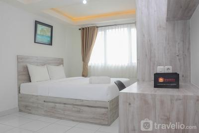 Comfy and Minimalist Studio at Amethyst Apartment By Travelio
