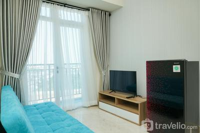 Simply Furnished 2BR @ Puri Orchard Apartment By Travelio
