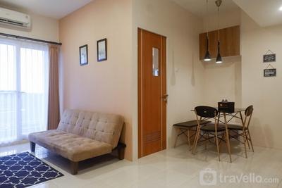 Best Price Pool View 2BR Apartment at Puncak Dharmahusada By Travelio