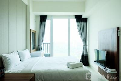 Homey Studio Room Tree Park Apartment near BSD City By Travelio