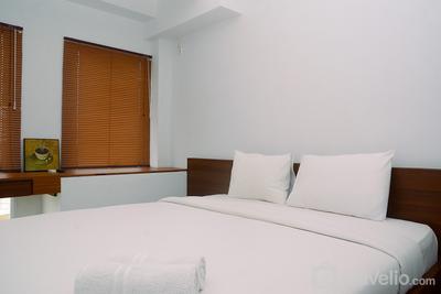 Cozy and Minimalist Studio Patraland Urbano Apartment near Bekasi Station By Travelio